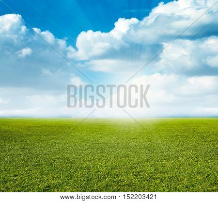 a beautiful grass field for the game of golf and sunny sky