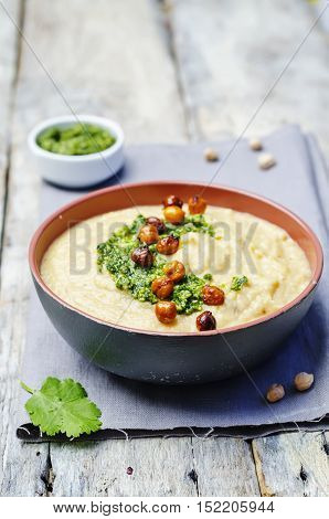 cauliflower chickpea soup with cilantro pesto and roasted chickpeas
