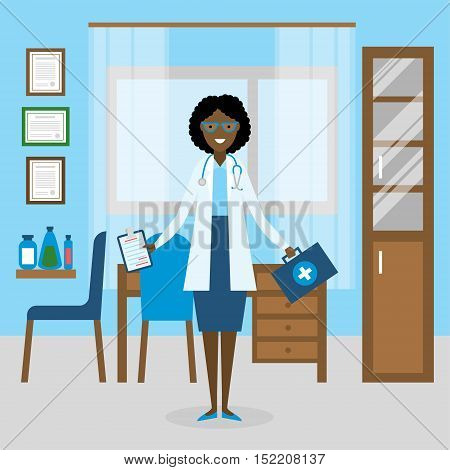 Doctor in the cabinet. Funny smiling african american female doctor in the medical cabinet. Medical treatment, first aid.
