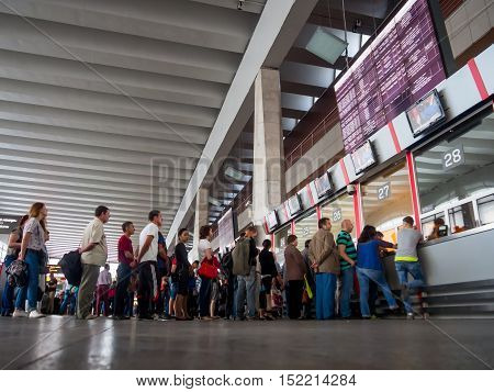Moscow, Russia - June 15, 2016: People stand in line for tickets at the ticket counter Kursky railway station Moscow