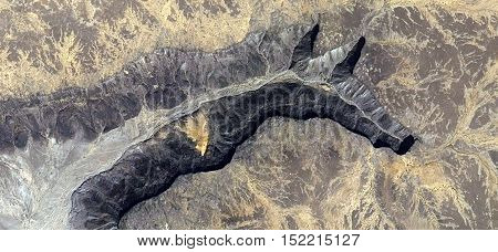 Abstract photography of landscapes of deserts of Africa from the air. fantasy forms of stone in the desert like a Okapi