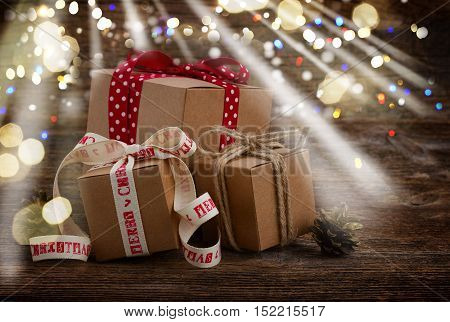 Carton handmade gift boxes on wooden background glimming bokeh and light