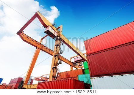 The overhead crane is working at the container terminal.