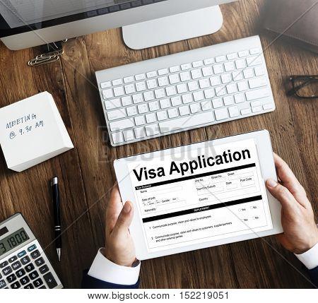 Business man hands visa application on tablet screen
