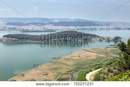 View of Ioannina and lake Pamvotis, Nissaki island in foreground, Epirus, Greece