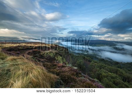 Scenic View of Hills Covered in Heather Flowers and Morning Mist