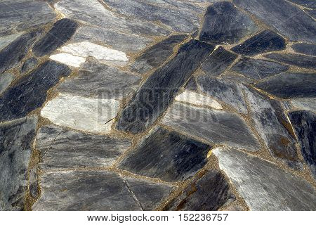 Detached rustic slate on the floor of a house