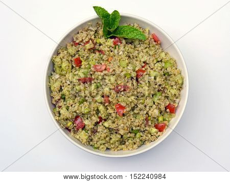 Tabouli: A cracked wheat salad made with tomato,cucumber, onion, parsley, mint, lemon juice and olive oil. Alternate spelling: Tabbouleh, Tabouleh, and Taboulee.