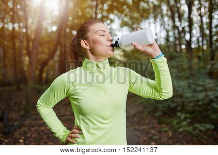 Sportswoman Drinking Isotonic Drink