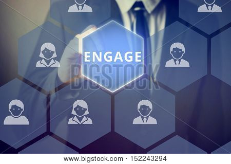 Businessman Touching 'engage' Word On Virtual Screen