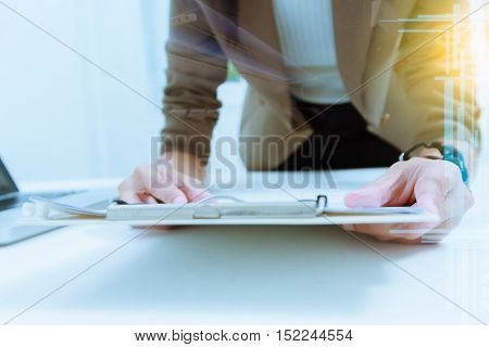 Business documents on office table with laptop computer,document business diagram and officer working in background,businesswoman meeting business plan.