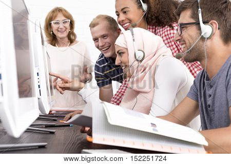 Smiled Students Looking At The Monitor Screen