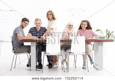 Group Of Listeners Sitting At The Table During The Language Course