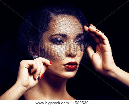 beauty brunette woman under black veil with red manicure close up, grieving widow, halloween makeup luxury concept