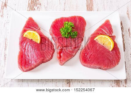 Fresh tuna steaks on the plate
