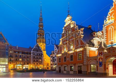City Hall Square with House of the Blackheads and Saint Roland Statue in Old Town of Riga at night, Latvia