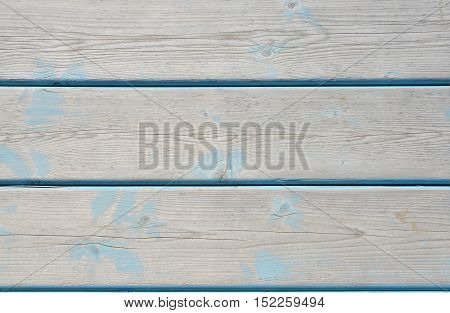 Beach wooden blue board with elements of sand in the cracks. Wood horizontal panel. Rustic wooden surface.