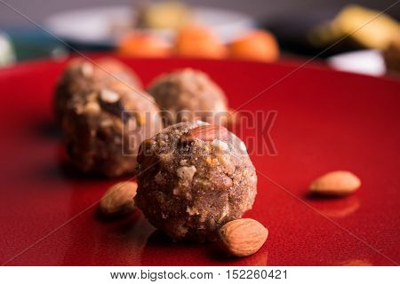 Indian sweet dry fruits and nuts laddu, which is a traditional, healthy, nutritious and popular dish, is made from items like dates, raisins, almonds, cashew nuts and flaxseeds, diwali food