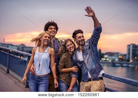 Group of friends enjoying a city tour together.