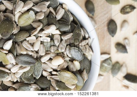 Sunflower, pumpkin and pine seeds in small bowl