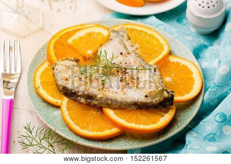 Orange Halibut Steaks on blue plate.seletive focus