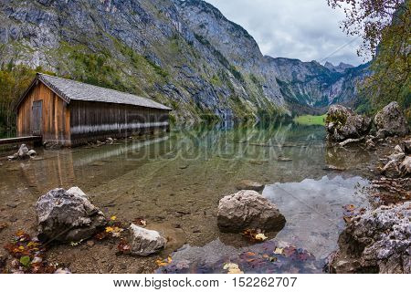 Boat garages on the shores. The concept of active tourism and ecotourism. Enchanted Lake Obersee in the Bavarian Alps
