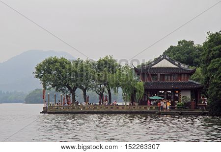 People Are Walking In Park Of The West Lake