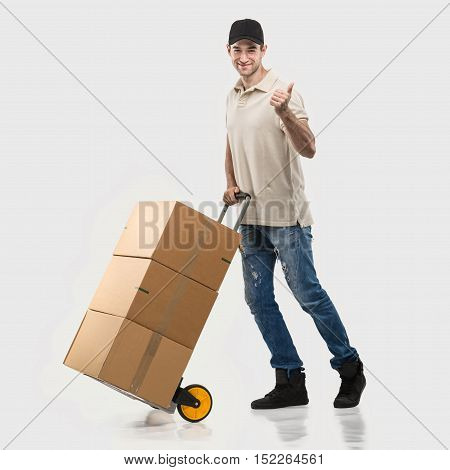 Courier - a handcart packages on grey