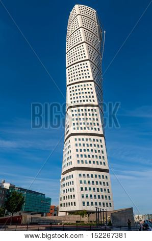 Malmo Sweden - August 04 2010: The twisted skyscraper Turning Torso seen from below on a sunny and warm summer day in Malmo Sweden at August 04 2010. Turning Torso is the most prominent landmark in Malmo - very modern and brave arcitcture.