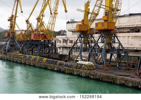 Odessa Ukraine - October 13 2016: Container cranes in cargo port terminal cargo cranes without job in an empty harbor port. A crisis. Defaulted paralyzed entire economy