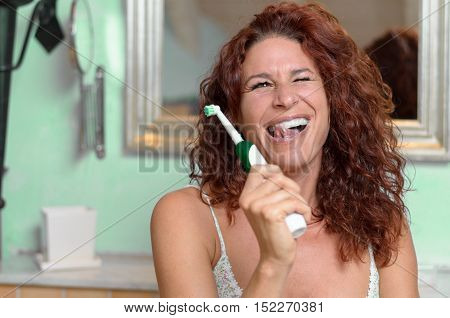 Woman Licking Teeth While Holding Toothbrush