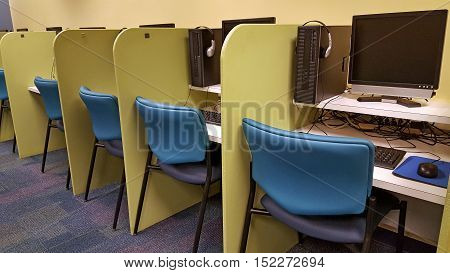 row of computers and cubicles in school classroom