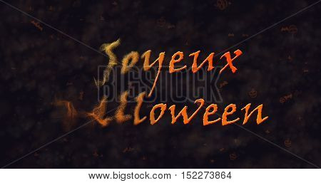 Joyeux Halloween text in French dissolving into dust to left