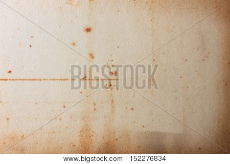 Grunge old paper texture with distinctive stain marks.