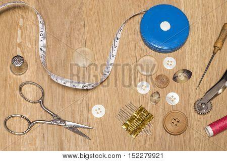 Various sewing items on a wooden background