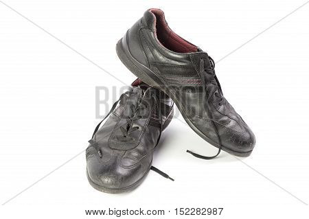 worn black men's shoes isolated isolated on white background