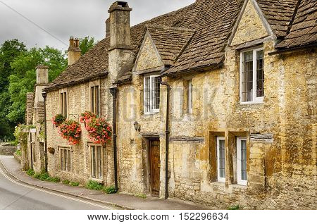 Flower boxes on stone houses in Castle Combe Village in Wiltshire, England.