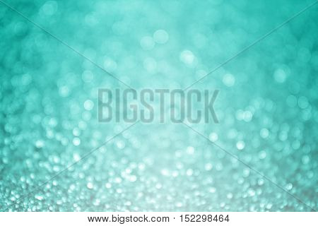 Abstract teal turquoise and mint aqua green glitter sparkle background or party invitation design