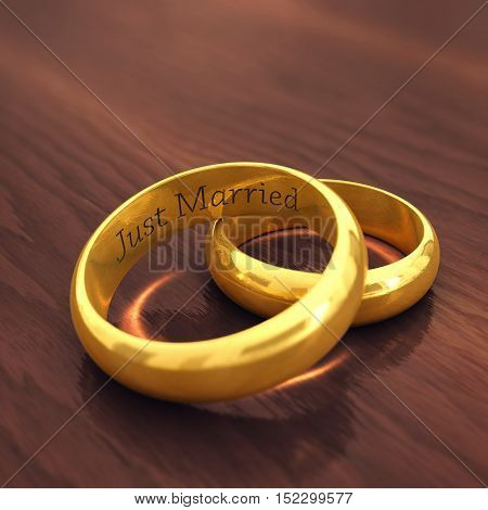 Golden wedding rings on wooden background engraved Just married , Wedding , 3d illustration