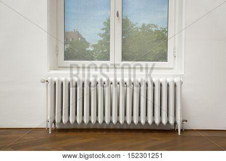 Heating radiator and window