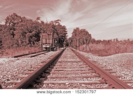 A look down the railroad tracks in the afternoon.