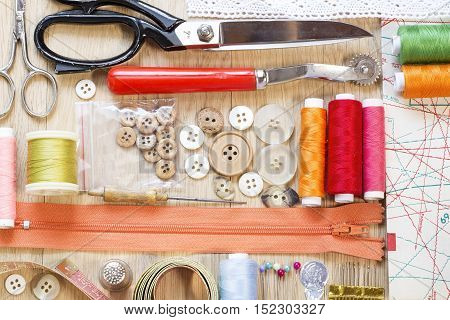 Sewing items close up on a wooden background