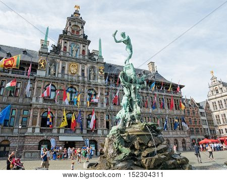 ANTWERP, BELGIUM - 10 SEPT. 2016: Tourists around Town Hall and Brabofontein fountain at the Great Square or Grote Markt in Antwerp, Belgium