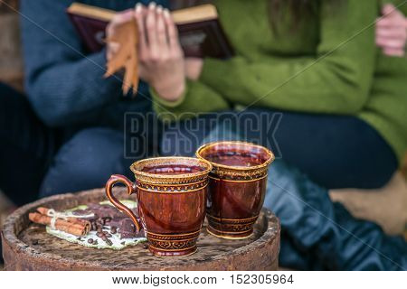 still life with two cups of coffee on the old oak barrel autumn