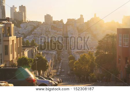 San Francisco Downtown street view. San Francisco Cityscape at sunset, California, USA. Warm vintage color grading.