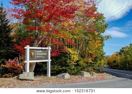 BAR HARBOR- OCTOBER 12 : Acadia National Park sign with beautiful autumn colors in Bar Harbor, USA on October 12, 2016