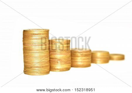 Golden coins on white background. Coins stacked on each other. Macro