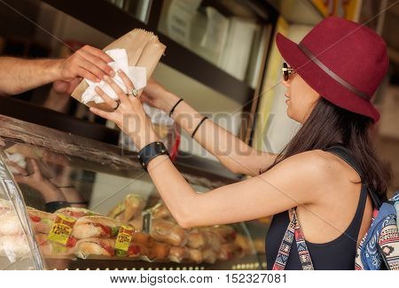 Young Woman Buys Fresh Pastries At Bakery Market
