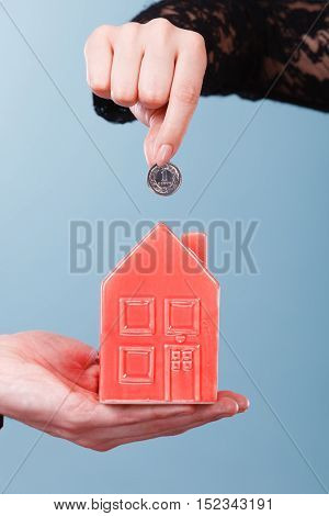 People Hands With Little House And Silver Coin.