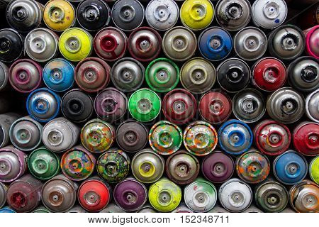 colorful stacked pile of used spray paint cans
